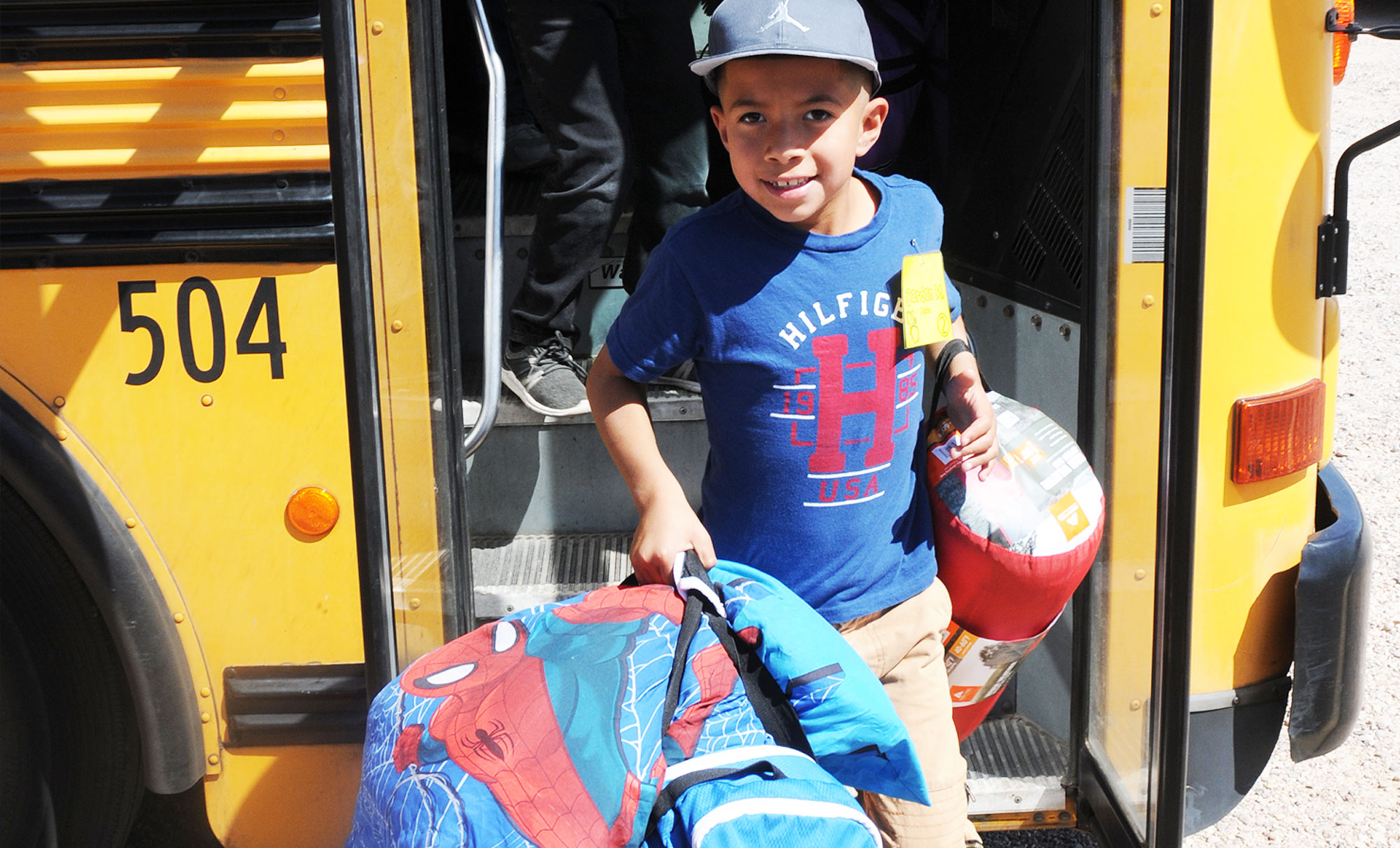 Camp Cooper overnights are unforgettable - picture of student arriving with overnight gear.